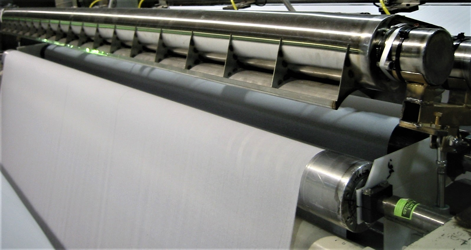 The optimised dust hood installed over a roller in the paper mill.